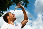 Sportsman With Water   First Aid for Heat Injuries