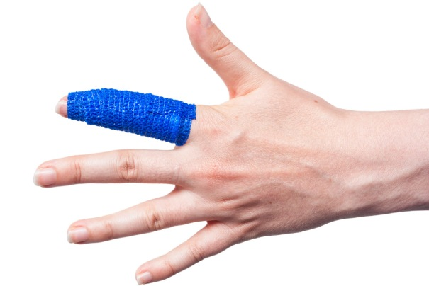 Cohesive Bandage Retaining a Dressing on a Finger
